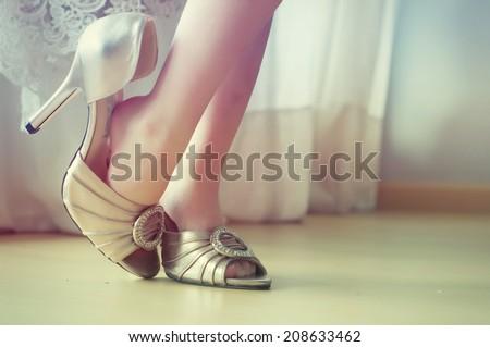 Little girl girl tries wedding shoes #208633462