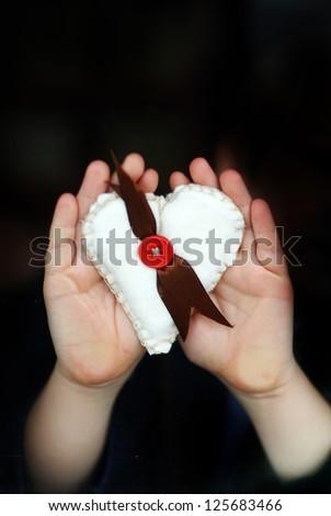 little girl gives a heart - stock photo