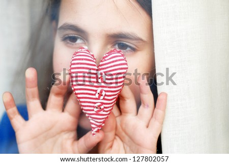 little girl gives a heart