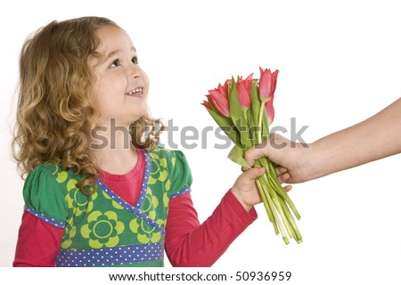 Little girl giving a tulip bouquet - stock photo