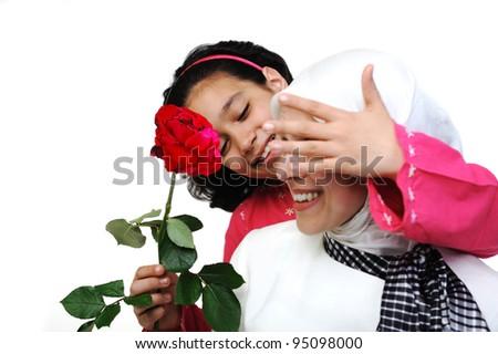 Little girl giving gift rose to her mom
