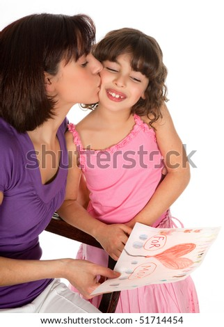 Little girl giving her mother a drawing for mother's day