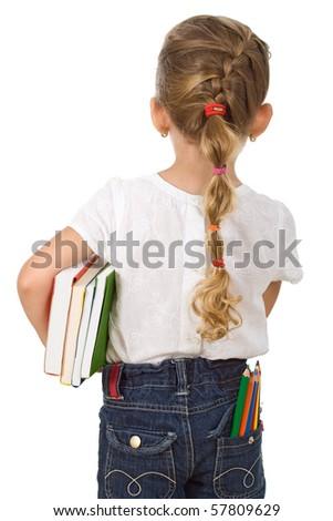 Little girl going back to school with lots of pencils and books - isolated - stock photo