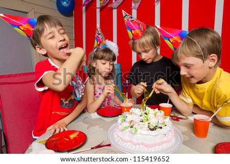 Little girl going to eat cake in her birthday round about her friends