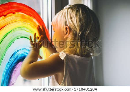 Little girl hands touch painting rainbow on window. Child Art and Creative. Kids leisure at home, childcare, safety joy symbol. Positive visual support during quarantine Coronavirus Covid-19 at home. ストックフォト ©
