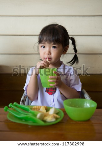 little girl have lunch at restaurant