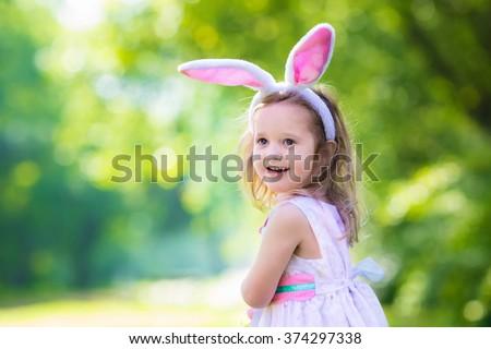 little girl having fun on...
