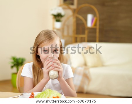 little girl having healthy meal at home