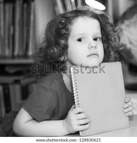 little girl holding a book
