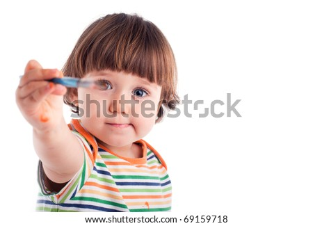 Little girl holding a brush in front of the eye