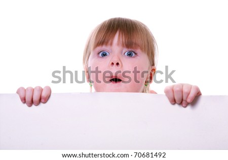 little girl holding a cardboard looking surprised. child hands.  isolated on white