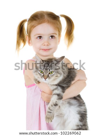 Little girl holding a cat looks up on white background