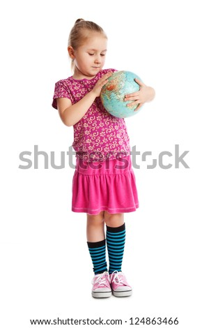 Little girl holding a globe. Studio shot.