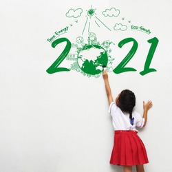 Little girl holding a paint brush painting creative environmental and eco-friendly, Save energy 2021 new year