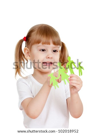 Little girl holding and showing on family cutting from paper