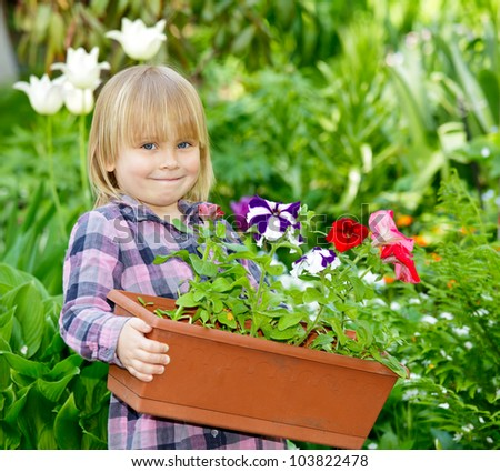 Little girl holding container with flowers