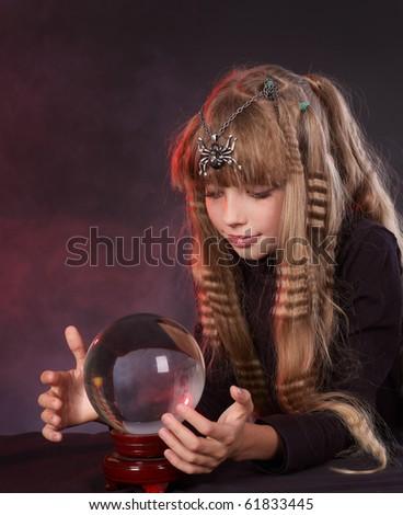 Little girl holding crystal ball.Series.