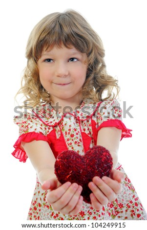 Little girl holding heart. Isolated on white background