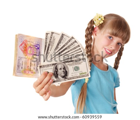 Little girl holding international passport and money. Foreign vacation.