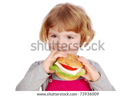little girl holding sandwich
