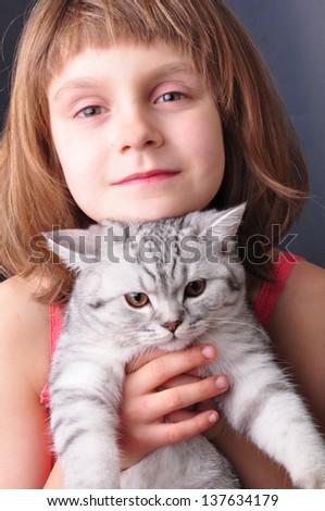little girl hugging het cat
