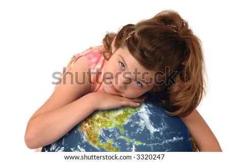 Little girl hugging planet earth against white background