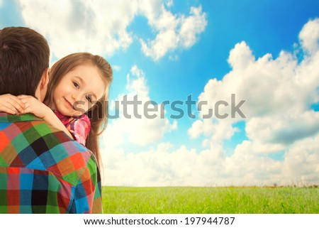 Little Girl hugs her father. Fathers day, family holiday, vacation