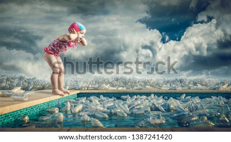 Little girl in a bathing suit screams on the edge of a pool full of plastic bottles. Concept of pollution and dependence on plastic.