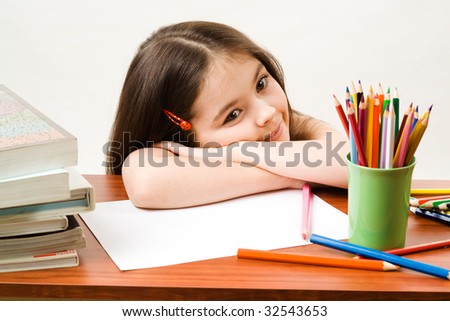 Little girl in a brown study