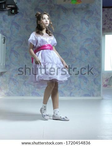 little girl in a dress looks like a doll Stock photo ©