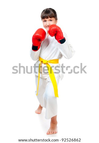 little girl in a kimono and boxing gloves