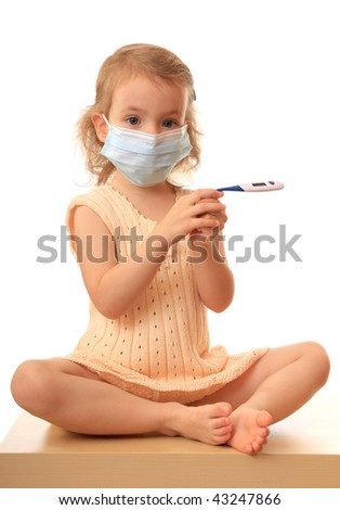 Little girl in a non-permanent medical mask with a thermometer.