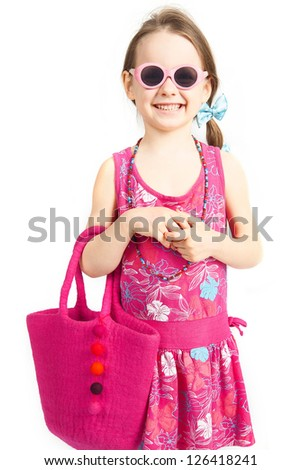 little girl in a pink dress as a fashion model