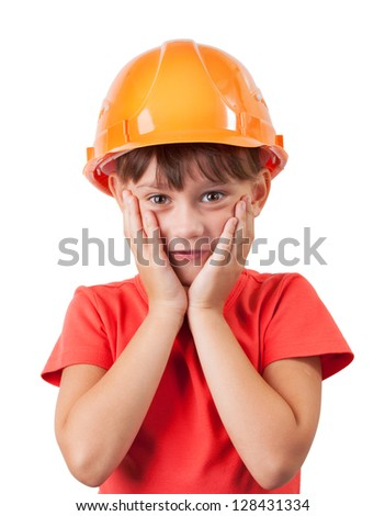 Little girl in a protective helmet on head