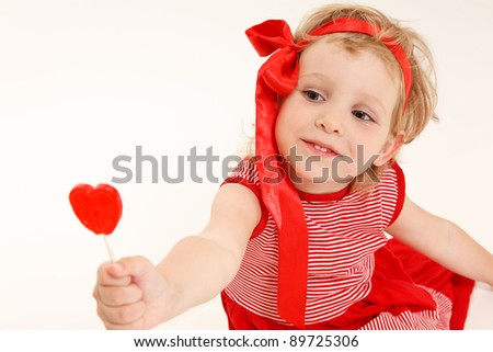 little girl in a red dress with sweet heart.