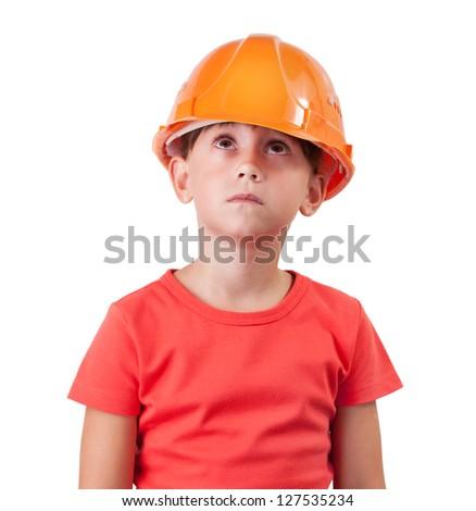Little girl in an orange helmet looking up
