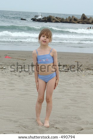 stock photo : Little girl in blue bikini on a beach. Save to a lightbox ▼