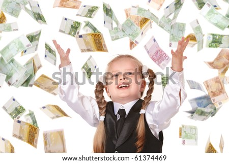 Little girl in business suit with flying money. Isolated.