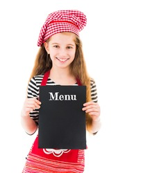 Little girl in chef uniform holding menu mockup with copy space in hands isolated on white background