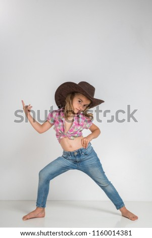 d81b883379cf5 Little girl in cowboy hat and jeans isolated on white background.   1160014381