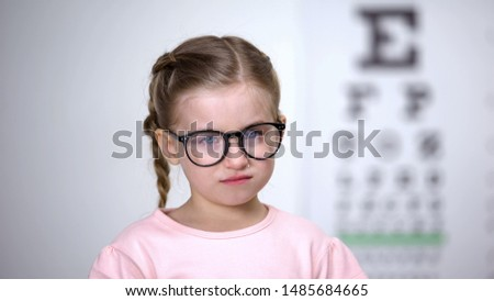 Little girl in eyeglasses crying feeling insecure, worrying about bullying