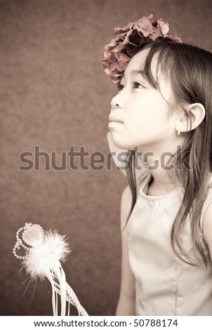 Little Girl in Fairy Outfit Looking Up - stock photo