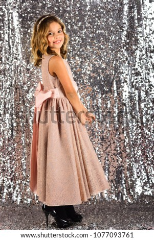 Little girl in fashionable dress, prom. Fashion and beauty, little princess. Fashion model on silver background, beauty. Child girl in stylish glamour dress, elegance. Look, hairdresser, makeup. #1077093761