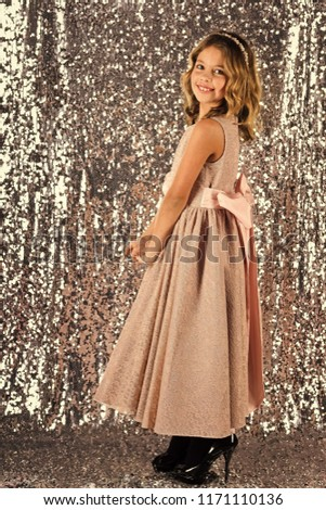Little girl in fashionable dress, prom. Fashion and beauty, little princess. Fashion model on silver background, beauty. Child girl in stylish glamour dress, elegance. Look, hairdresser, makeup #1171110136