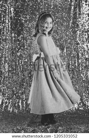 Little girl in fashionable dress, prom. Fashion and beauty, little princess. Look, hairdresser, makeup. Child girl in stylish glamour dress, elegance. Fashion model on silver background, beauty. #1205331052