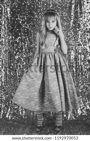 Little girl in fashionable dress, prom. little girl in glamour style #1192970053