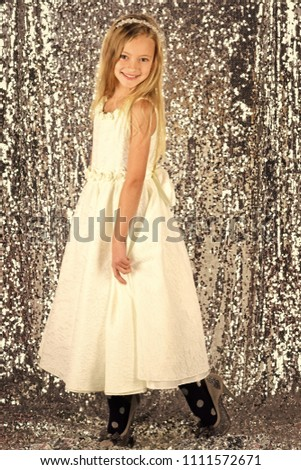 Little girl in fashionable dress, prom. Look, hairdresser, makeup. look fashion and beauty #1111572671