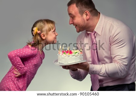 Little girl in her birthday with her father