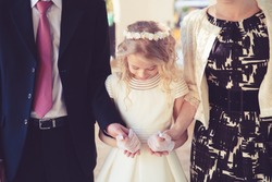 Little Girl in her First Communion Day with Her Father and mother.