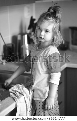 little girl in kitchen